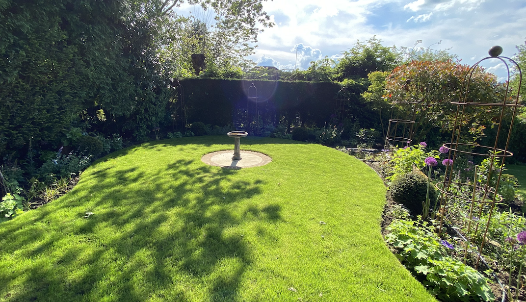 Circular lawn with central feature